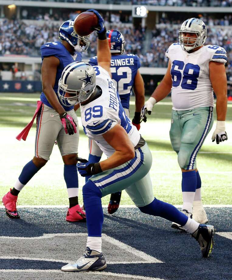 Dallas Cowboys tight end John Phillips (89) celebrates his touchdown against the New York Giants  during the second half of an NFL football game Sunday, Oct. 28, 2012 in Arlington, Texas. (AP Photo/Sharon Ellman) Photo: Sharon Ellman, Associated Press / FR170032 AP