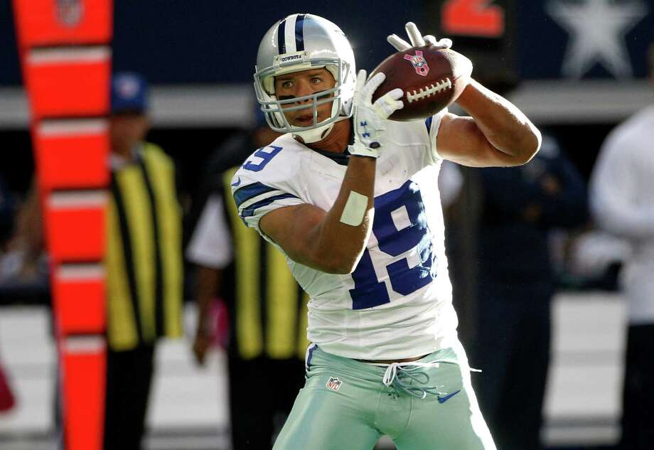 Dallas Cowboys wide receiver Miles Austin (19) grabs a pass in the second half of a NFL football game against the New York Giants Sunday, Oct. 28, 2012, in Arlington, Texas. The Giants defeated the Cowboys 29-24. (AP Photo/Tony Gutierrez) Photo: Tony Gutierrez, Associated Press / AP