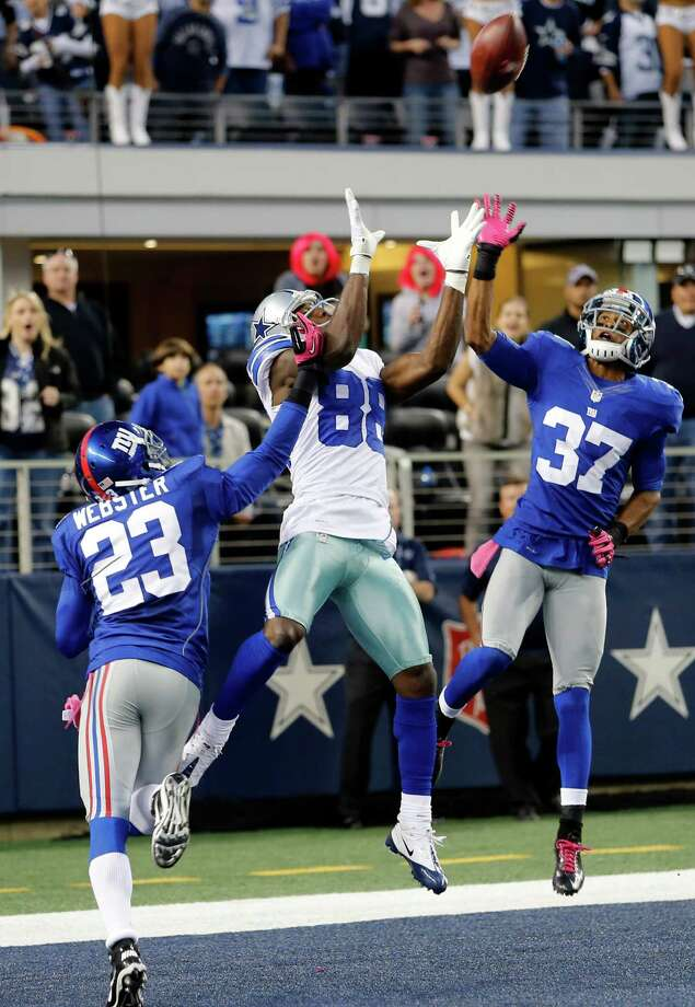 Dallas Cowboys wide receiver Dez Bryant (88) makes a last minute reception between New York Giants cornerback Corey Webster (23) and cornerback Michael Coe (37) for a touchdown that was nullified after review at NFL football game Sunday, Oct. 28, 2012 in Arlington, Texas. The Giants won 29-24. (AP Photo/Sharon Ellman) Photo: Sharon Ellman, Associated Press / FR170032 AP