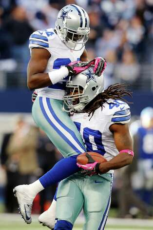 Dallas Cowboys strong safety Danny McCray (40) celebrates with Morris Claiborne (24) after intercepting the ball against the New York Giants during the second half of an NFL football game, Sunday, Oct. 28, 2012, in Arlington, Texas. The Giants won 29-24. (AP Photo/Sharon Ellman) Photo: Sharon Ellman, Associated Press / FR170032 AP