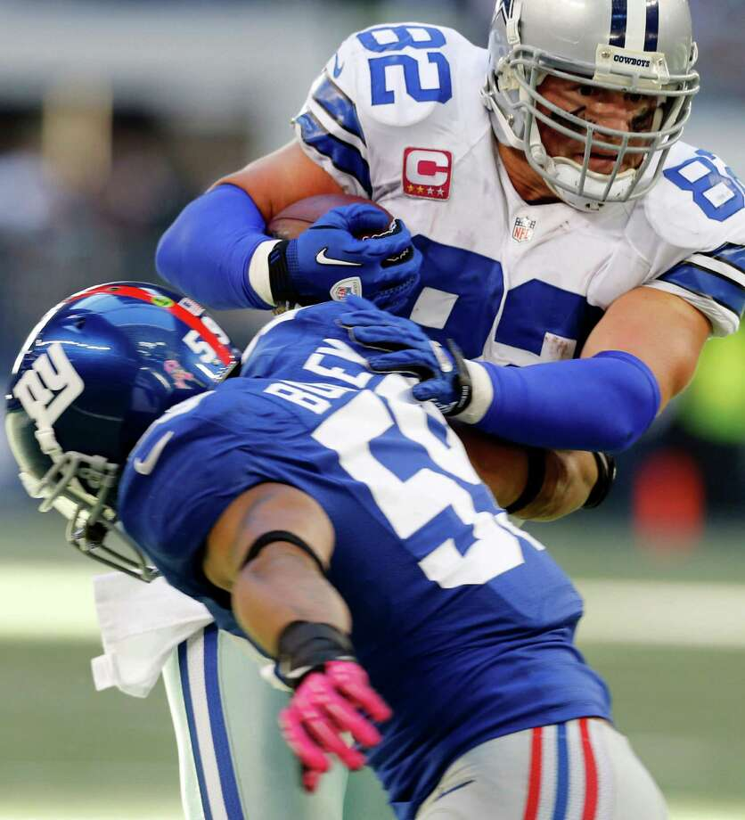 Dallas Cowboys tight end Jason Witten (82) pushes past New York Giants outside linebacker Michael Boley (59) during the second half of an NFL football game, Sunday, Oct. 28, 2012, in Arlington, Texas. (AP Photo/Sharon Ellman) Photo: Sharon Ellman, Associated Press / FR170032 AP