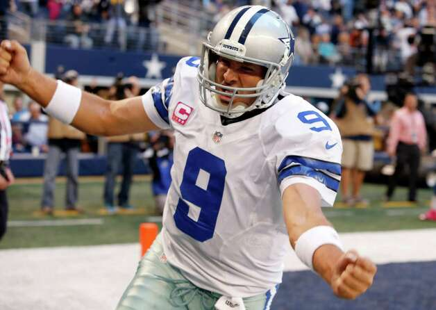 Dallas Cowboys quarterback Tony Romo (9) celebrates his touchdown against the New York Giants during the second half of an NFL football game Sunday, Oct. 28, 2012 in Arlington, Texas.(AP Photo/Sharon Ellman) Photo: Sharon Ellman, Associated Press / FR170032 AP