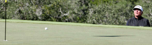 Tommy Armour III watches his putt on 16 during the final round of the 2012 AT&T Championship on Sunday Oct. 28, 2012 at the AT&T Canyons course. David Frost defeated Bernhard Langer on the second hole of a sudden death playoff to win the event. Photo: Edward A. Ornelas, Express-News / © 2012 San Antonio Express-News