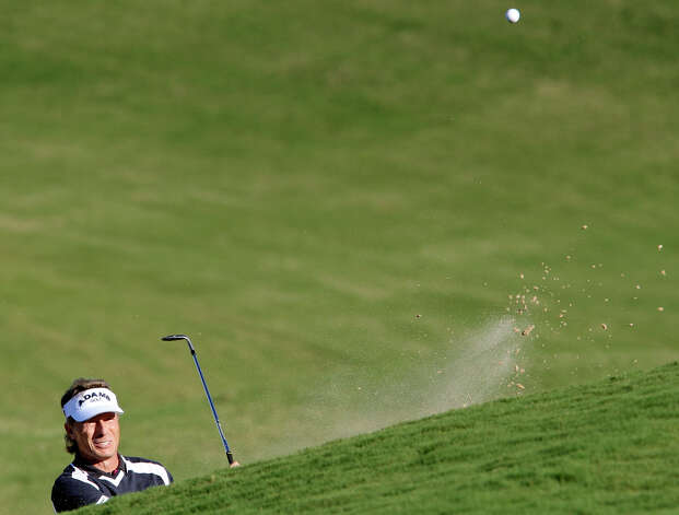 Bernhard Langer hits out of a bunker on 18 during the final round of the 2012 AT&T Championship on Sunday Oct. 28, 2012 at the AT&T Canyons course. David Frost defeated Langer on the second hole of a sudden death playoff to win the event. Photo: Edward A. Ornelas, Express-News / © 2012 San Antonio Express-News