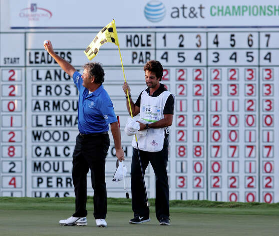 David Frost (left) reacts after defeating Bernhard Langer (not pictured) on the second playoff hole to win the 2012 AT&T Championship during the final round Sunday Oct. 28, 2012 at the AT&T Canyons Course at TPC San Antonio as his son and caddie Sean Frost looks on. Photo: Edward A. Ornelas, Express-News / © 2012 San Antonio Express-News