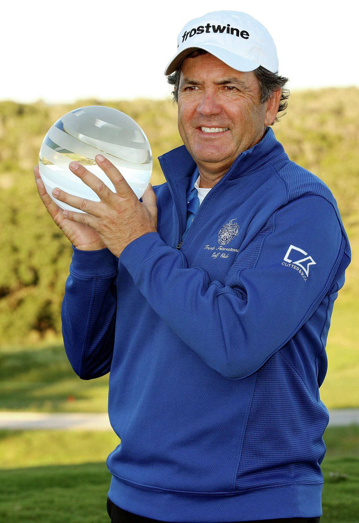 David Frost poses with the trophy after defeating Bernhard Langer on the second playoff hole during the final round of the 2012 AT&T Championship on Sunday Oct. 28, 2012 at the AT&T Canyons Course at TPC San Antonio.