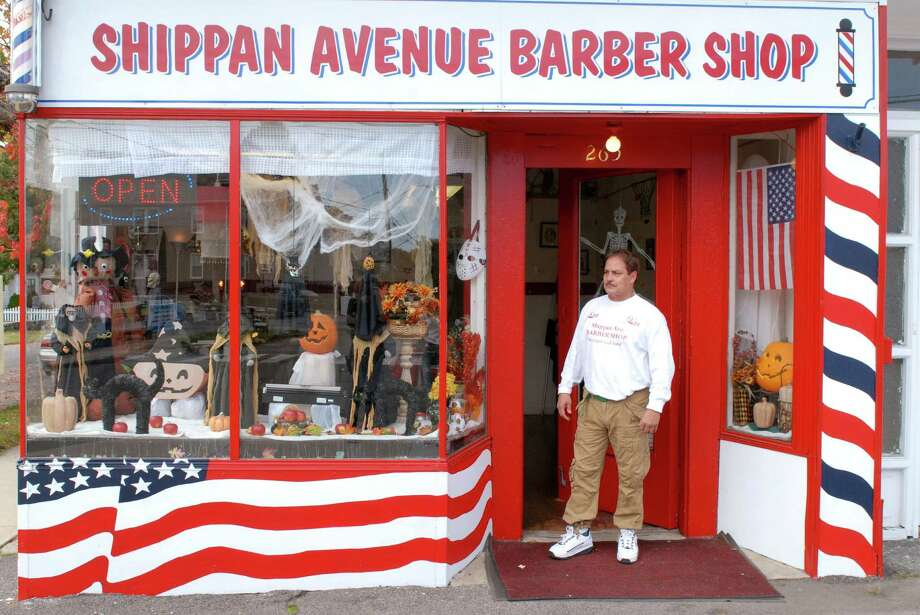 Michael Vega stands outside his barber shop in Stamford, Conn. on Friday October 26, 2012. He decorates the shop and window for every holiday. Photo: Dru Nadler