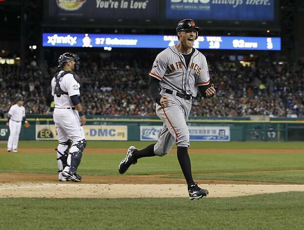 Giants' right fielder Hunter Pence reacts after crossing the plate on a Brandon Belt triple in the 2nd inning during game 4 of the World Series at Comerica Park on Sunday, Oct. 28, 2012 in Detroit, MI. Photo: Michael Macor, The Chronicle