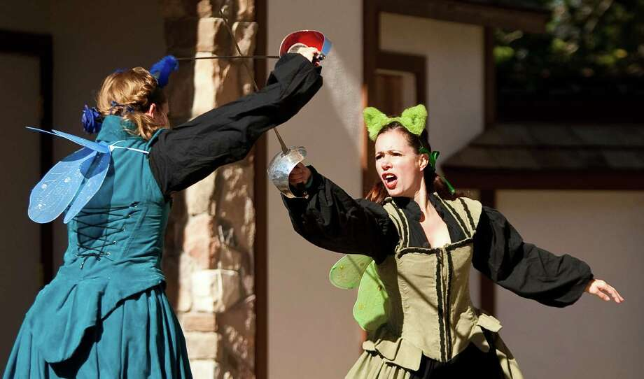 The Steele Sisters' Nicole Skelly, facing,  and Samantha McDonald, fight it out in a combat style of comedy act during the Texas Renaissance Festival, Sunday, Oct. 28, 2012,  in Todd Mission. The show consists of a rivalry of two sisters mixing in bawdy humor and sword fighting. The festival will continue until November 25th. Photo: Nick De La Torre, Houston Chronicle / Houston Chronicle