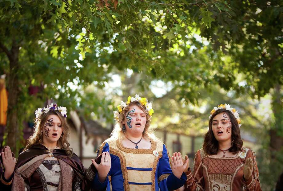 A street madrigal choir performs for Texas Renaissance Festival visitors, Sunday, Oct. 28, 2012,  in Todd Mission. The festival will continue until November 25th. Photo: Nick De La Torre, Houston Chronicle / Houston Chronicle