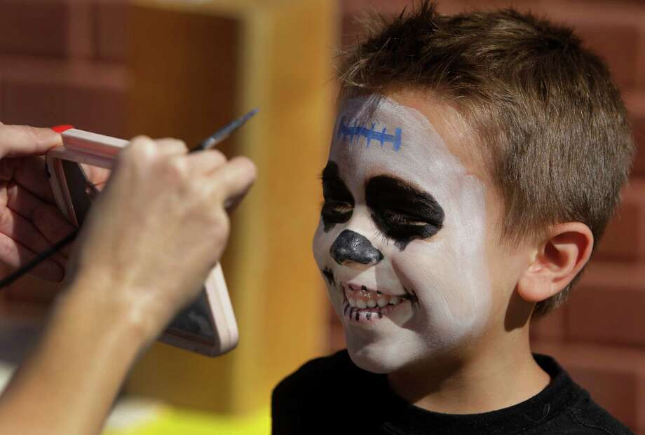 Benjamin Garza, 6, of Houston checks out his painted face in mirror during the Día de los Muertos Festival at MECA, Multicultural Education And Counseling through the Arts ,1900 Kane Street, Sunday, Oct. 28, 2012, in Houston. The two-day Día de los Muertos Festival is a public celebration of community folk art traditions that commemorate family and community ancestors. Festival events included community altar exhibits, foods from Latin American countries, vendors selling Day of the Dead arts and crafts, and live performances of music and dance. Photo: Melissa Phillip, Houston Chronicle / © 2012 Houston Chronicle