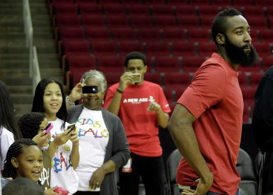 Fans watch newly acquired Houston Rockets' guard James Harden during open practice at Toyota Center Sunday, Oct. 28, 2012, in Houston. Photo: Melissa Phillip, Houston Chronicle / Houston Chronicle