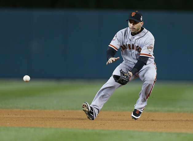 Giants' 2nd baseman Marco Scutaro scoops up a Tigers' left fielder Quintin Berry grounder in the 1st inning during game 4 of the World Series at Comerica Park on Sunday, Oct. 28, 2012 in Detroit, MI. Photo: Michael Macor, The Chronicle