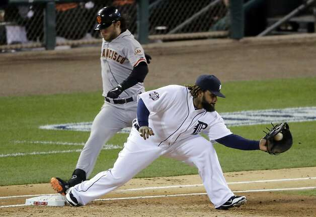 San Francisco Giants shortstop Brandon Crawford (35) beats the tag at first base as Detroit Tigers first baseman Prince Fielder reaches for the ball during the third inning of Game 4 of baseball's World Series Sunday, Oct. 28, 2012, in Detroit. (AP Photo/Charlie Riedel) Photo: Charlie Riedel, Associated Press