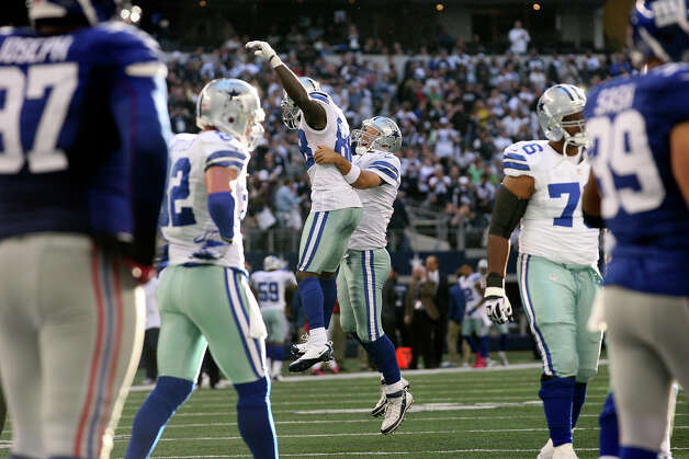 Dallas Cowboys' Tony Romo, center right, celebrates with teammate Dez Bryant after scoring a touchdown against the New York Giants in the second half at Cowboys Stadium in Arlington, Texas, Sunday, Oct. 28, 2012. The Giants won, 29-24. Photo: Jerry Lara, Express-News / © 2012 San Antonio Express-News