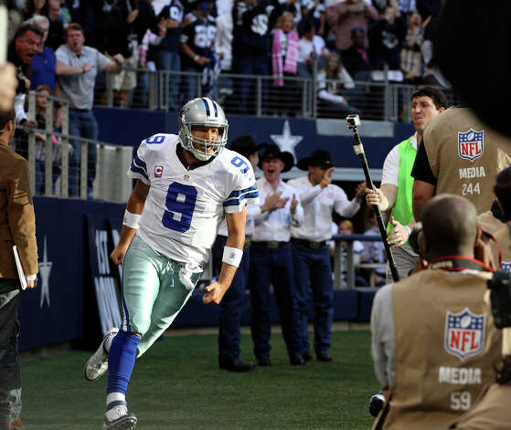 Dallas Cowboys' Tony Romo celebrates afte scoring a touchdown against the New York Giants during the second half at Cowboys Stadium in Arlington, Texas, Sunday, Oct. 28, 2012. The Giants won, 29-24. Photo: Jerry Lara, Express-News / © 2012 San Antonio Express-News