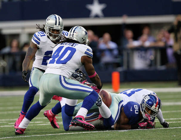 Dallas Cowboys' Danny McCray, intercepts the ball intended for New York Giants' Victor Cruz, (80), during the second half at Cowboys Stadium in Arlington, Texas, Sunday, Oct. 28, 2012. The Giants won, 29-24. Photo: Jerry Lara, Express-News / © 2012 San Antonio Express-News