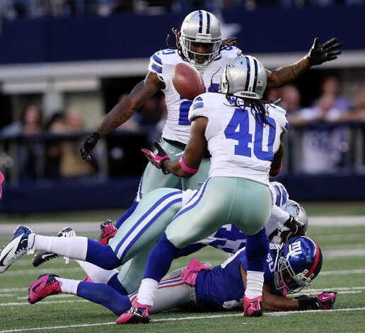 Dallas Cowboys' Danny McCray, intercepts the ball intended for New York Giants' Victor Cruz during the second half at Cowboys Stadium in Arlington, Texas, Sunday, Oct. 28, 2012. The Giants won, 29-24. Photo: Jerry Lara, Express-News / © 2012 San Antonio Express-News