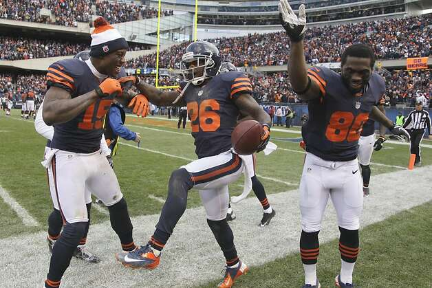 Bears cornerback Tim Jennings (26) celebrates his interception return for a touchdown. Photo: Nam Y. Huh, Associated Press
