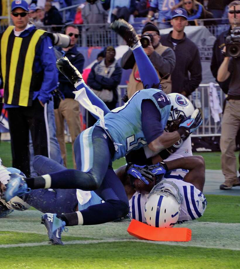 Colts running back Vick Ballard was ruled to have reached the corner of the end zone for the winning touchdown while taking a a hit from Michael Griffin. Photo: Frederick Breedon, Stringer / Getty Images North America