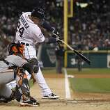Tigers' third baseman Miguel Cabrera hits a 2-run homer in the 3rd inning during game 4 of the World Series at Comerica Park on Sunday, Oct. 28, 2012 in Detroit, MI.