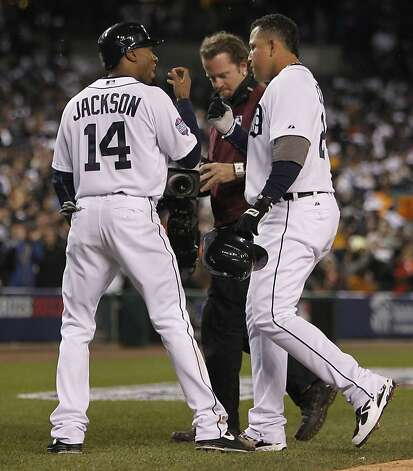 Tigers' center fielder Austin Jackson greets Miguel Cabrera after scoring on Cabrera's 2-run homer in the 3rd inning during game 4 of the World Series at Comerica Park on Sunday, Oct. 28, 2012 in Detroit, MI. Photo: Michael Macor, The Chronicle