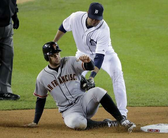San Francisco Giants first baseman Brandon Belt (9) gets caught stealing second base as Detroit Tigers third baseman Miguel Cabrera tags him out during the fourth inning of Game 4 of baseball's World Series Sunday, Oct. 28, 2012, in Detroit. (AP Photo/Charlie Riedel) Photo: Charlie Riedel, Associated Press
