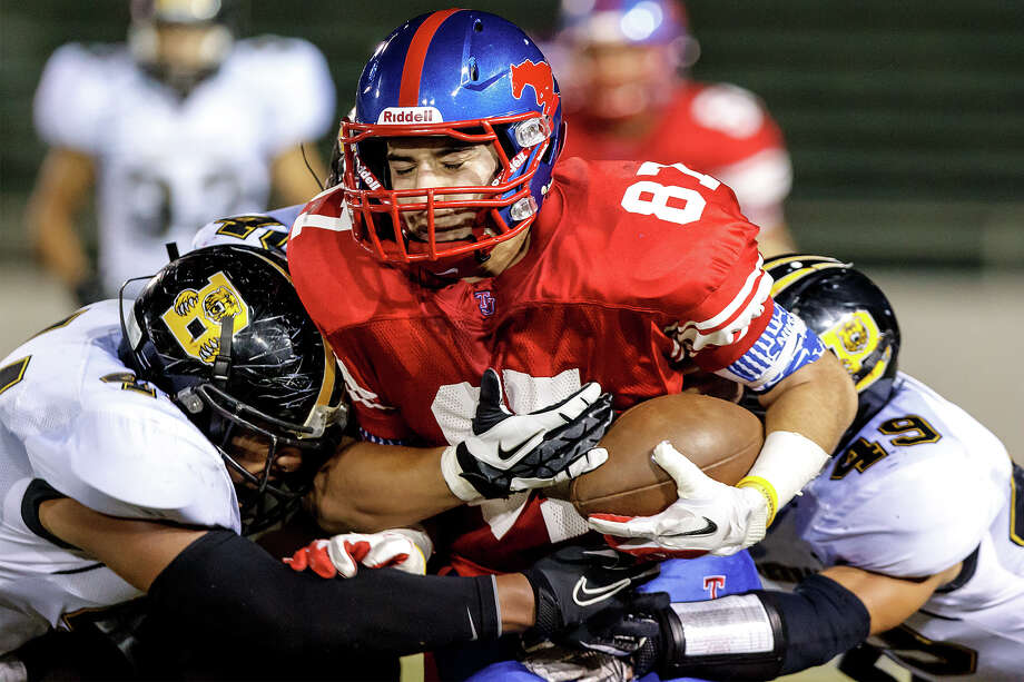 Jefferson's Ralph Lazarine (center) is tackled by Brennan's Grant Watanabe (left) and Michael Huron during the fourth quarter of their game at Alamo Stadium on Nov. 2, 2012.  Brennan won the game 14-0.  MARVIN PFEIFFER/ mpfeiffer@express-news.net Photo: MARVIN PFEIFFER, Marvin Pfeiffer/ Express-News / Express-News 2012