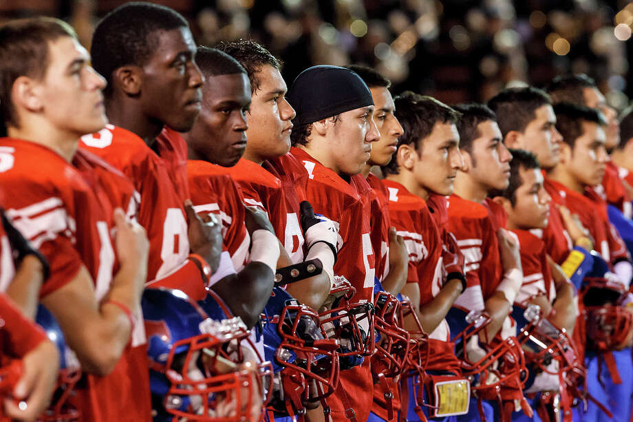 The Jefferson Mustangs stand at attenion as the National Anthem is sung prior to their game with Brennan at Alamo Stadium on Nov. 2, 2012.  Brennan won the game 14-0.  MARVIN PFEIFFER/ mpfeiffer@express-news.net Photo: MARVIN PFEIFFER, Marvin Pfeiffer/ Express-News / Express-News 2012