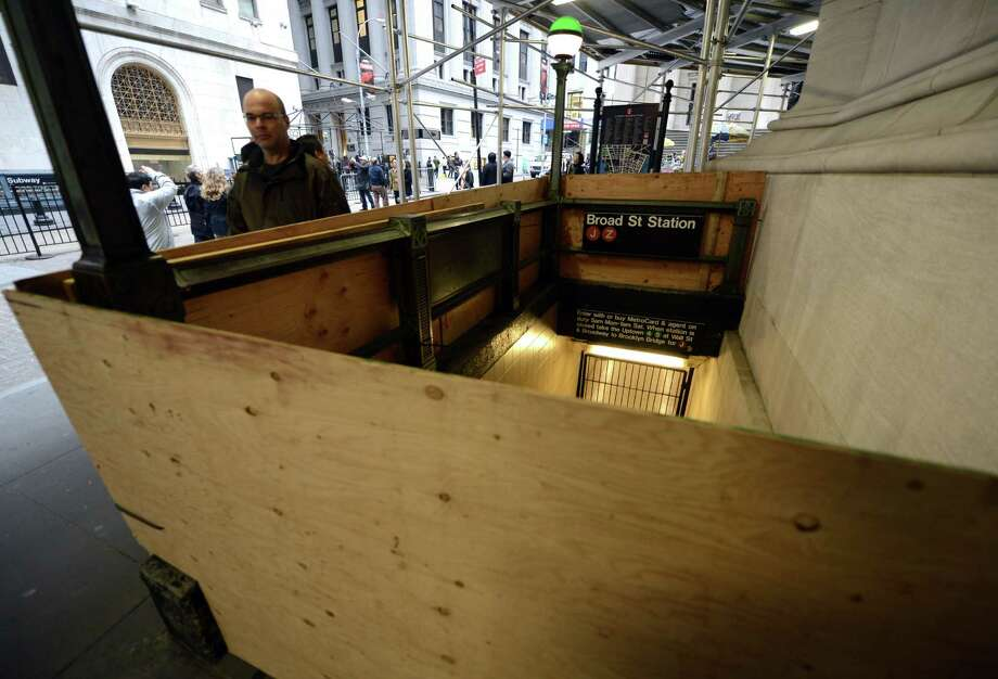 The Broad Street subway station across from the New York Stock Exchange  is boarded up as residents of lower Manhattan evacuate the city in preparation for the arrival of Hurricane Sandy's winds and rain. Photo: TIMOTHY A. CLARY, Staff / AFP