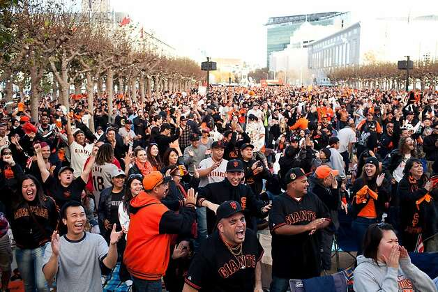 Gevo Lopez, 29, center, and thousands of other fans react to a Giants run at a World Series viewing party at Civic Center in San Francisco, Calif., Sunday, October 28, 2012. Photo: Jason Henry, Special To The Chronicle