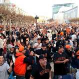 Gevo Lopez, 29, center, and thousands of other fans react to a Giants run at a World Series viewing party at Civic Center in San Francisco, Calif., Sunday, October 28, 2012.