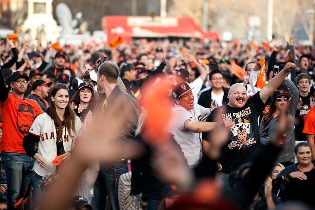 Thousands of other fans react to a Giants run at a World Series viewing party at Civic Center in San Francisco, Calif., Sunday, October 28, 2012. Photo: Jason Henry, Special To The Chronicle