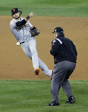 San Francisco Giants shortstop Brandon Crawford makes a play on a ball hit by Detroit Tigers' Quintin Berry during the fifth inning of Game 4 of baseball's World Series Sunday, Oct. 28, 2012, in Detroit. (AP Photo/Paul Sancya ) Photo: Paul Sancya, Associated Press