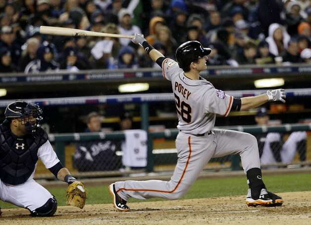 San Francisco Giants' Buster Posey hits a home run during the sixth inning of Game 4 of baseball's World Series against the Detroit Tigers Sunday, Oct. 28, 2012, in Detroit. (AP Photo/David J. Phillip) Photo: David J. Phillip, Associated Press
