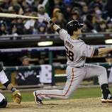 San Francisco Giants' Buster Posey hits a home run during the sixth inning of Game 4 of baseball's World Series against the Detroit Tigers Sunday, Oct. 28, 2012, in Detroit. (AP Photo/David J. Phillip)