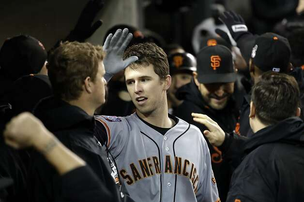 San Francisco Giants' Buster Posey celebrates in the dugout after hitting a two-run home run during the sixth inning of Game 4 of baseball's World Series against the Detroit Tigers Sunday, Oct. 28, 2012, in Detroit. (AP Photo/David J. Phillip) Photo: David J. Phillip, Associated Press