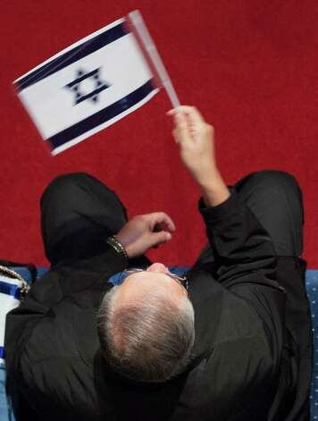"An attendee waves an Israeli flag during ""A Night to Honor Israel,"" Sunday, Oct. 28, 2012, at Cornerstone Church in San Antonio. Photo: Darren Abate, Darren Abate/For The Express-New"