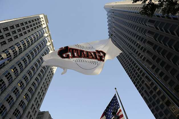A large Giants flag flies at the Bank of America building on California St. in San Francisco, Sunday October 28th, 2012. Photo: Michael Short, Special To The Chronicle