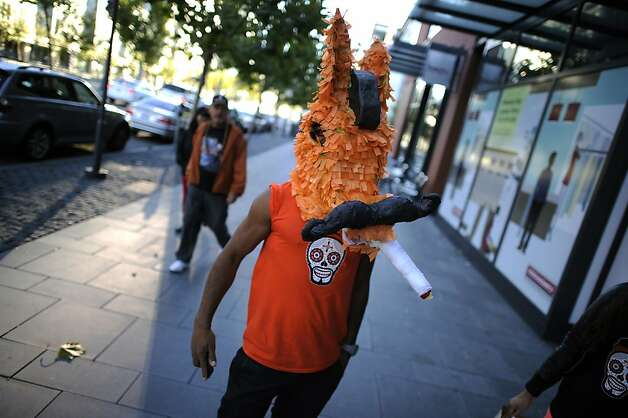 Antonio Partida of San Francisco is seen on King St. wearing paper mache donkey head in support of the Giants near AT&T park in San Francisco, Sunday October 28th, 2012. Photo: Michael Short, Special To The Chronicle