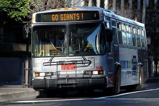 "The 14 Mission bus has a ""Go Giants"" sign playing on it's front display as it drives down Mission St. in San Francisco, Sunday October 28th, 2012. Photo: Michael Short, Special To The Chronicle"
