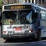 "The 14 Mission bus has a ""Go Giants"" sign playing on it's front display as it drives down Mission St. in San Francisco, Sunday October 28th, 2012."