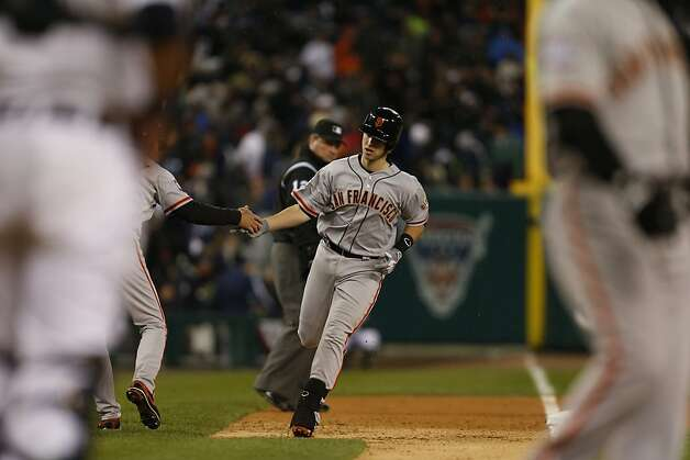 Giants' catcher Buster Posey heads home after hitting a 2-run homer in the 6th inning during game 4 of the World Series at Comerica Park on Sunday, Oct. 28, 2012 in Detroit, MI. Photo: Michael Macor, The Chronicle