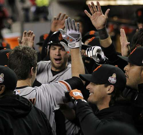 Giants' catcher Buster Posey is greeted in the dugout after hitting a 2-run homer in the 6th inning during game 4 of the World Series at Comerica Park on Sunday, Oct. 28, 2012 in Detroit, MI. Photo: Michael Macor, The Chronicle