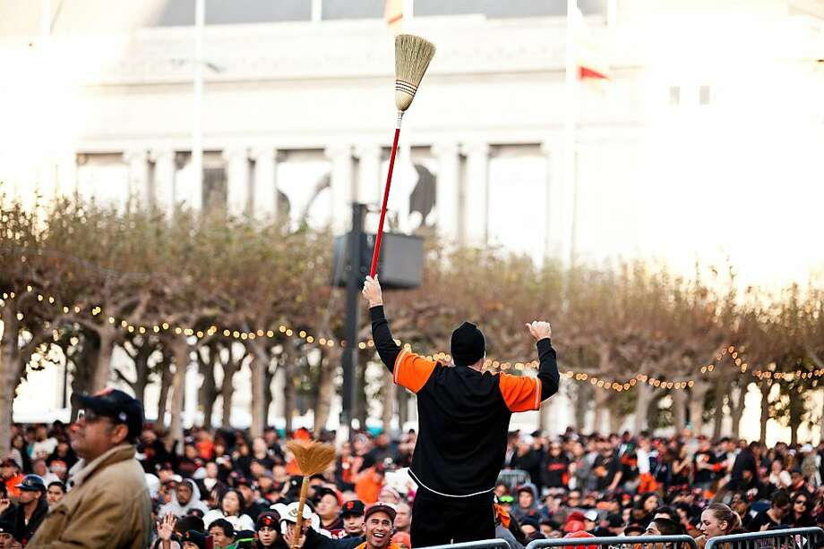 A man holding a broom for the sweep at a World Series viewing party at Civic Center in San Francisco, Calif., Sunday, October 28, 2012. Photo: Jason Henry, Special To The Chronicle