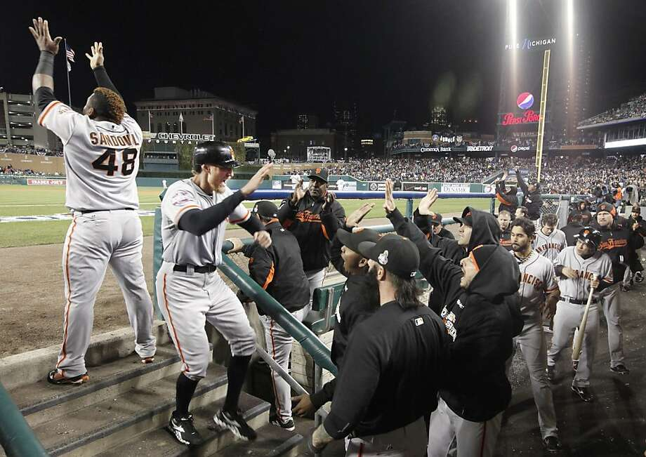 Giants right fielder Hunter Pence gets a warm welcome from his teammates after scoring the game's first run on Brandon Belt's triple in the second inning. Photo: Michael Macor, The Chronicle
