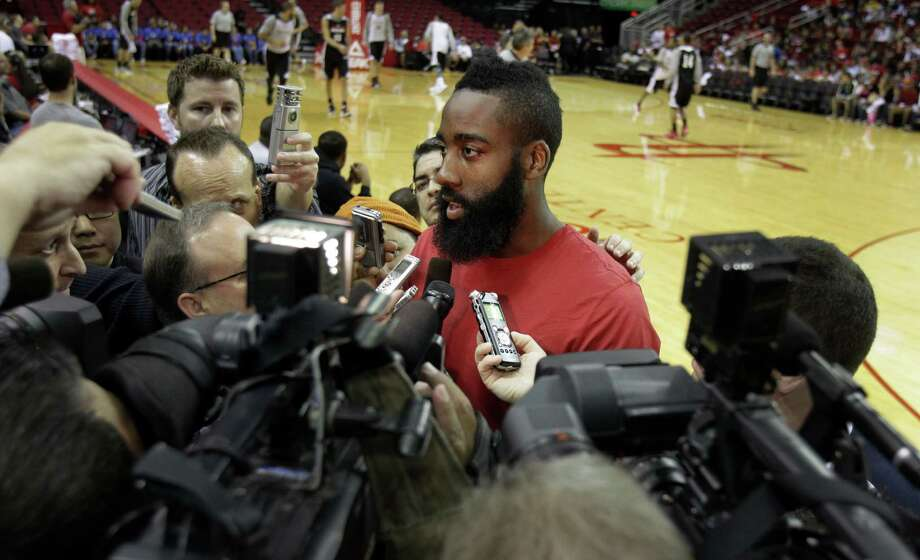 The welcoming committee for new Rockets guard James Harden included a bevy of cameras and microphones during Sunday's open practice at Toyota Center. Photo: Melissa Phillip, Staff / Houston Chronicle