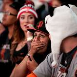 Fans react to a Tigers home run at a World Series viewing party at Civic Center in San Francisco, Calif., Sunday, October 28, 2012.