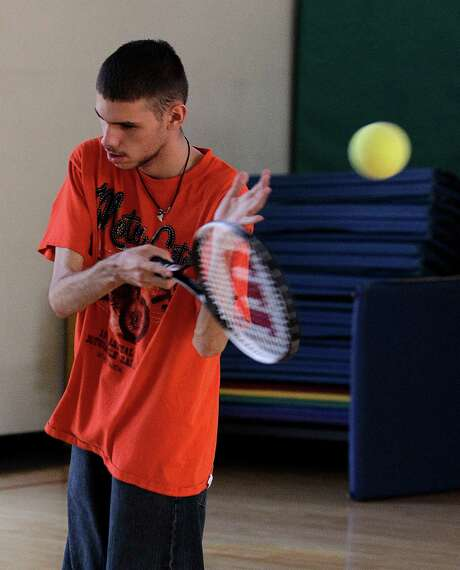 In Austin Benavidez, who is blind, practices his tennis serve using an oversized ball filled with ball bearings at the California School for the Blind in Fremont. Photo: Ben Margot, STF / AP