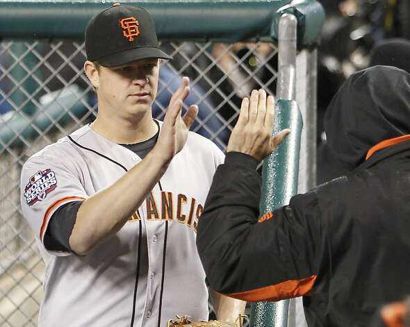 Giants' pitcher Matt Cain is greeted in the dugout after the 7th inning during game 4 of the World Series at Comerica Park on Sunday, Oct. 28, 2012 in Detroit, MI. Photo: Michael Macor, The Chronicle